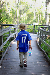 04 June 2015. Jean Lafitte National Historic Park, Louisiana.<br /> Ben in the swamp at the Barataria Preserve wetlands south or New Orleans.<br /> Photo©; Charlie Varley/varleypix.com