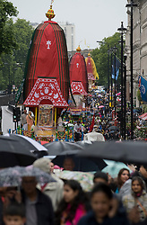 © licensed to London News Pictures. 12/06/2011. London, UK. Three 40-foot high colourful chariots being pulled from Hyde Park to Trafalgar Square as pert of the Hare Krishna Ratha-yatra Festival of Chariots. The giant chariots are accompanied by a procession of singers, musicians, and dancers. Rathayatra is celebrated by devotees of Lord Krishna all over the world. Photo credit should read: Ben Cawthra/LNP
