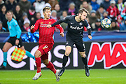 Red Bull Salzburg defender Andreas Ulmer (17) beats Liverpool forward Roberto Firmino (9) to the ball during the Champions League match between FC Red Bull Salzburg and Liverpool at the Red Bull Arena, Salzburg, Austria on 10 December 2019.