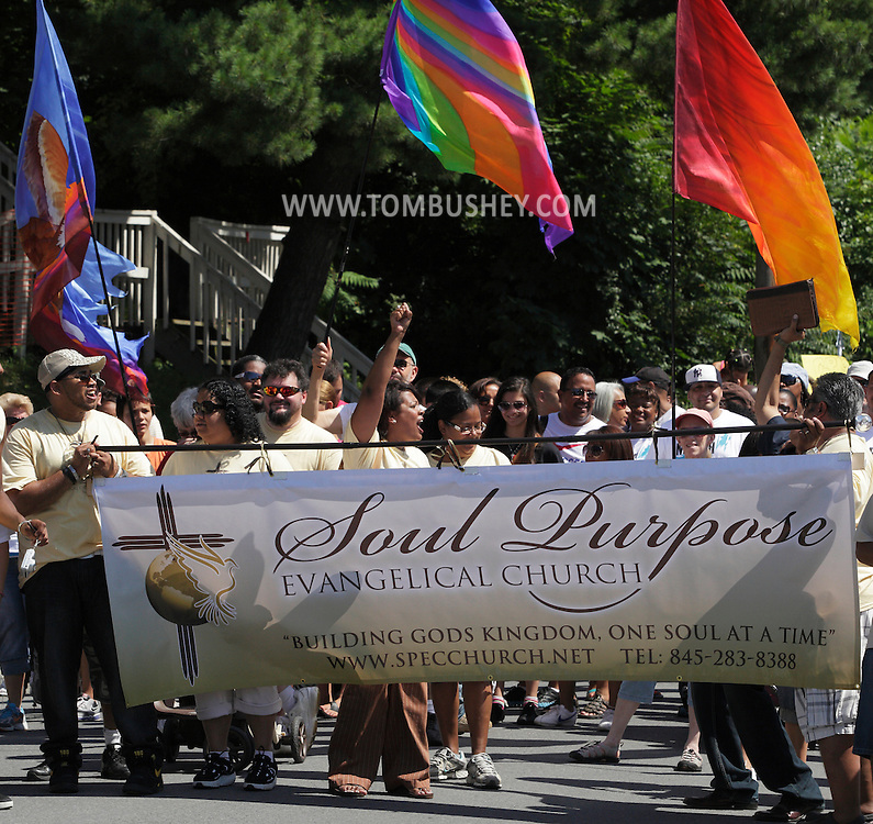 Middletown, New York - People with banners and flags walk down North Street during a March for Jesus on July 9, 2011.