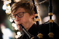 9 December 2017, Oslo, Norway: 22-year-old Nikolai Huse from Norway plays the bagpipes on the streets of Oslo. He's been playing the instrument for seven years, since he was 15 years old.