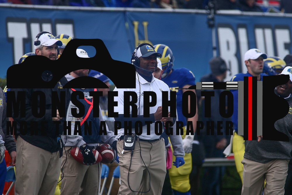 University of Delaware interim football coach DENNIS DOTTIN-CARTER, CENTER, watches the game from the sideline in the second quarter of a week eight game between the Delaware Blue Hens and the Stony Brook Seawolves, Saturday, Oct. 22, 2016 at Tubby Raymond Field at Delaware Stadium in Newark, DE.