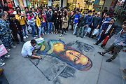 CHONGQING, CHINA - NOVEMBER 18:  china out - Finland out<br /> <br /> A disabled tramp, 52, paints Mona Lisa in the street on November 18, 2013 in Chongqing, China. <br /> ©Exclusivepix