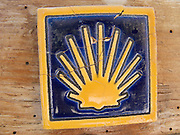 This colourful tile features the Way of Saint James scallop shell symbol. It could be found in many forms all along the Camino de Santiago de Compostela in Northern Spain.