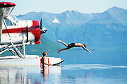 Alaska, Wood-Tickchik State Park. Swimming from float plane.