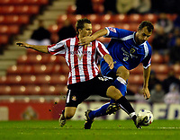 Photo: Jed Wee.<br /> Sunderland v Cardiff City. Coca Cola Championship. 31/10/2006.<br /> <br /> Sunderland's Tobias Hysen (L) tackles Cardiff's Riccardo Scimeca.