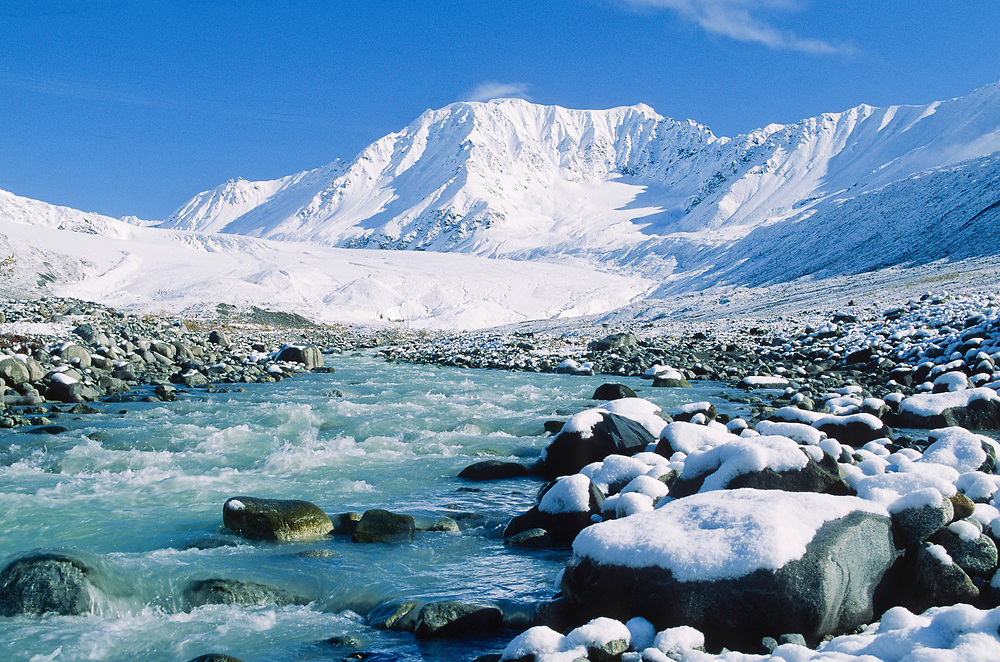 Alaska . Gulkana River and glacier. Winters first snow.