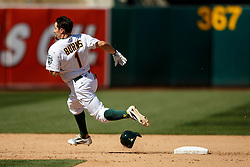 OAKLAND, CA - APRIL 17:  Billy Burns #1 of the Oakland Athletics rounds second base after hitting a triple against the Kansas City Royals during the eighth inning at the Oakland Coliseum on April 17, 2016 in Oakland, California.  The Oakland Athletics defeated the Kansas City Royals 3-2. (Photo by Jason O. Watson/Getty Images) *** Local Caption *** Billy Burns