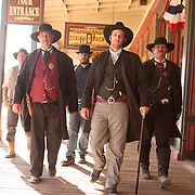 Actors walk the streets of Tombstone in character between re-enactments of the infamous gunfight at the OK Corral in Tombstone, Arizona. From left to right: Benjamin Caron (as Tom McLaury), Greg King (as Virgil Earp), Jeremy Caron (as Ike Clanton), Erik Servia (as Doc Holliday) and Kirk Opperman (as Wyatt Earp).
