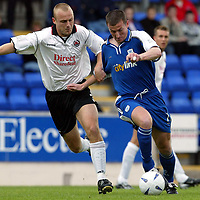 St Johnstone v Clyde..  05.10.02<br />Chris Hay is held by Simon Mensing<br /><br />Pic by Graeme Hart<br />Copyright Perthshire Picture Agency<br />Tel: 01738 623350 / 07990 594431