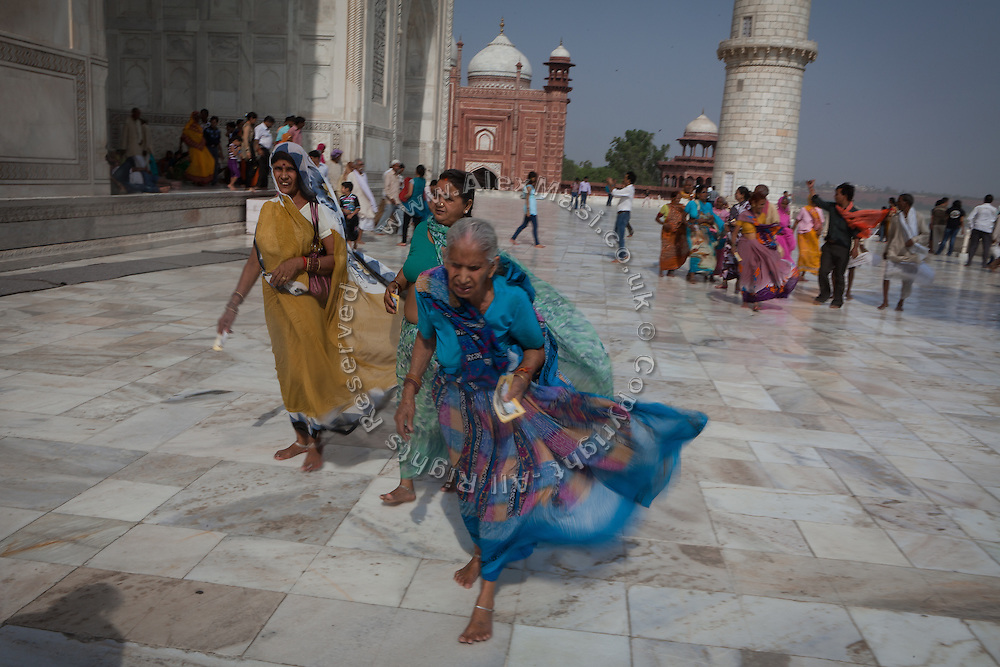 Visitors are enjoying a day at the Taj Mahal building, despite the heavy wind, in Agra.