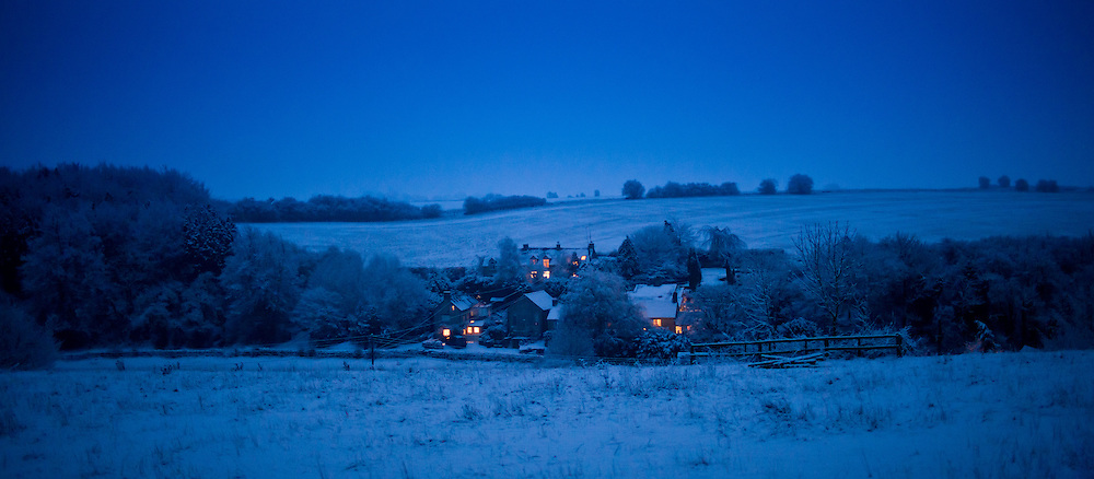 Snow scene across the valley in The Cotswolds, Swinbrook, Oxfordshire, United Kingdom