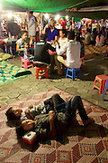 Phnom Penh, Cambodia. Night Market. LKids having a nap.