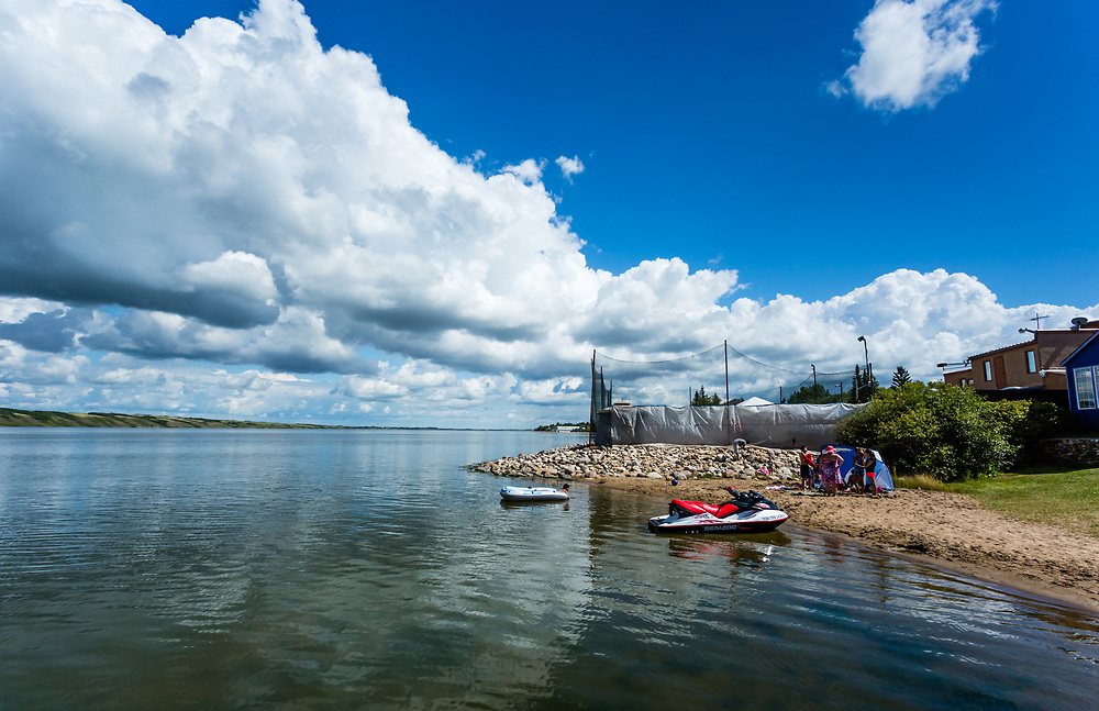 When they used to arrive by special excursion train from all across the prairies, they took to Little Manitou Lake in small wooden boats. Today they drive by car and play on inflatable dinghies and personal watercraft. Times change, but summertime at Manitou Beach is timeless.