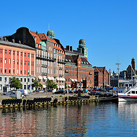 Buildings along Inre Hamnen in Malm&ouml;, Sweden<br /> For over two hundred years starting in the late 1700s, Inre Hammen was the major harbor for shipping into and out of Malm&ouml;. Today, the Inner Harbor is mostly used for small craft and tourist boats. The street on the left is Skeppsbron. Two of the notable buildings appearing just beyond the bow of the docked ship are (right to left) the Central Station and the old post office.