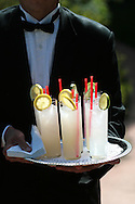 A waiter carries drinks at a wedding in Calistoga, California in the Napa Valley Wine Country on Saturday, May 10, 2008. (Photo by Kevin Bartram)