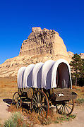 Conestoga wagon under Eagle Rock on the Oregon Trail, Scotts Bluff National Monument, Nebraska USA