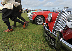 © Licensed to London News Pictures. 17/09/2011. GOODWOOD, UK. The Goodwood Revival at Goodwood in West Sussex today (17 September 2011). The revival is the world's largest historic motor race meeting, which relieves the 'glorious' days of the race circuit. Competitors and enthusiasts all dress in period fashion to enhance the experience. Photo credit : Stephen Simpson/LNP