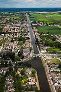 Nederland,Overijssel, Vriezenveen, 30-06-2011. Het Overijsselsch kanaal doorkruist Vriezenveen..Canal crossing the village of Vriezenveen..luchtfoto (toeslag), aerial photo (additional fee required).copyright foto/photo Siebe Swart