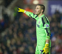 STOKE-ON-TRENT, ENGLAND - Sunday, January 12, 2014: Stoke City's goalkeeper Jack Butland in action against Liverpool during the Premiership match at the Britannia Stadium. (Pic by David Rawcliffe/Propaganda)