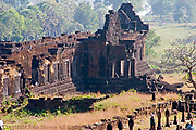A stone wall section on the lower level is on display at the ruins of ancient and historic Angkor era Wat Phu, built by the Khmers, in Champasak, Laos. Wat Phu was granted UNESCO World Heritage status in 2001.