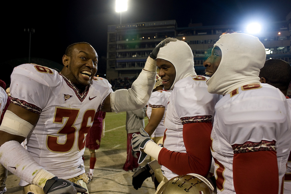 College Park, Maryland - Florida State University football players congratulate teammate Myron Rolle during the away game at College Park, Maryland, the day that Myron learned he won a Rhodes Scholarship..Photo by Susana Raab