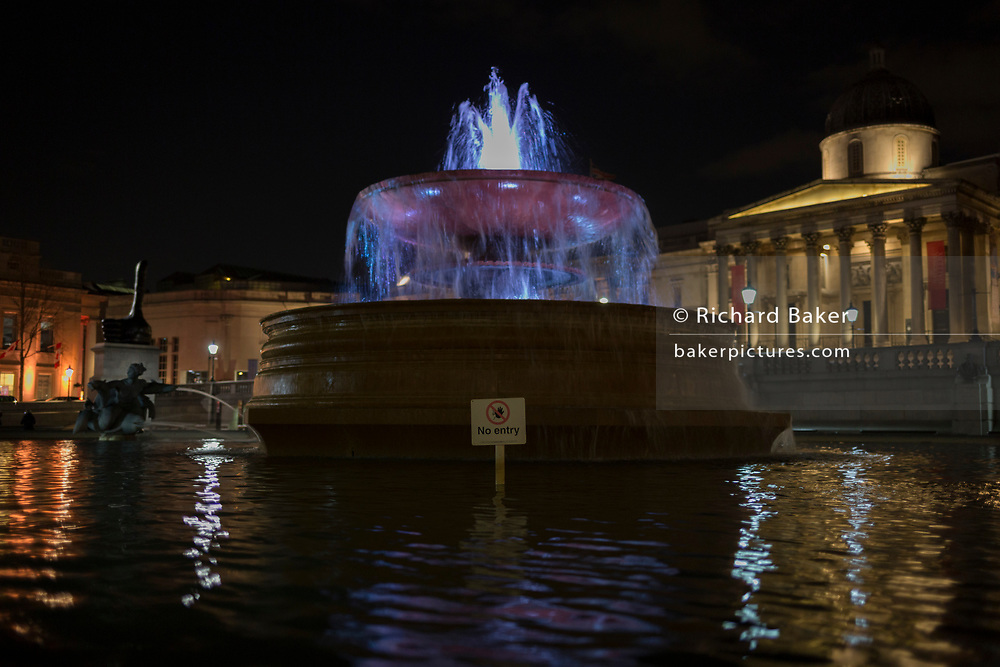 A No Entry sign warning visitors to Trafalgar Square, beneath one of the fountains in front of the National Gallery, on 21st March 2017, in London, England.
