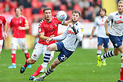 Charlton Athletic defender Jason Pearce (6) and Preston North End forward Tom Barkhuizen (29) during the EFL Sky Bet Championship match between Charlton Athletic and Preston North End at The Valley, London, England on 3 November 2019.
