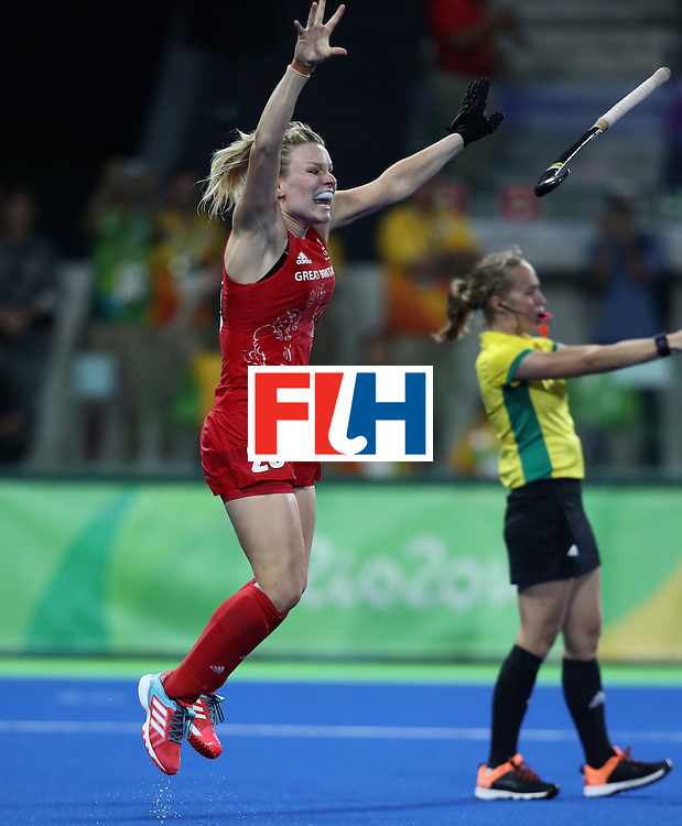 RIO DE JANEIRO, BRAZIL - AUGUST 19:  Hollie Webb of Great Britain celebrates after scoring the winning penalty against the Netherlands during the Women's hockey Gold medal match between The Netherlands and Great Britain on Day 14 of the Rio 2016 Olympic Games held at the Olympic Hockey Centre on August 19, 2016 in Rio de Janeiro, Brazil.  (Photo by David Rogers/Getty Images)
