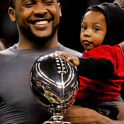 December 22, 2012; New Orleans, LA, USA; Louisiana-Lafayette Ragin Cajuns quarterback Terrance Broadway with his son Terrance Joseph Broadway II following a win over the East Carolina Pirates in the New Orleans Bowl at the Mercedes-Benz Superdome. UL-Lafayette defeated East Carolina 43-34. Mandatory Credit: Derick E. Hingle-USA TODAY Sports