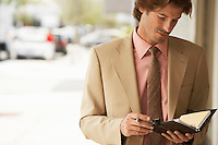 Businessman reading diary in street close-up
