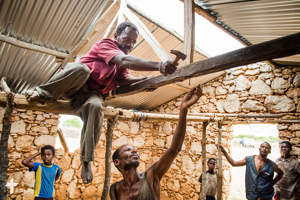 Workers construct the support structure to hold a tin roof on their Fiangonana Loterana Malagasy (FLM, Malagasy Lutheran Church) church in Besolohotse, southern Madagascar, on Tuesday, Oct. 21, 2014.  The tin roof was given by The Lutheran Church–Missouri Synod.  LCMS Communications/Erik M. Lunsford