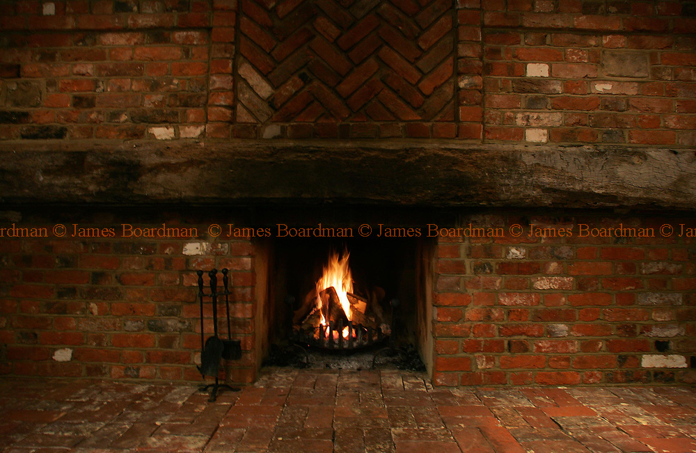 JAMES BOARDMAN / 07967642437 - 01444 412089 <br />The inglenook fire place at 'The Barn' in Fairlight, East Sussex.