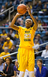 West Virginia Mountaineers guard Tyrone Hughes (23) shoots a three pointer against the TCU Horned Frogs at the WVU Coliseum.