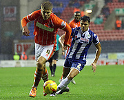 Blackpool Midfielder Brad Potts and Wigan Defender Reece James battle during the Sky Bet League 1 match between Wigan Athletic and Blackpool at the DW Stadium, Wigan, England on 12 December 2015. Photo by Pete Burns.