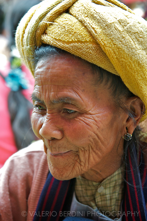 An old woman shops in the market.