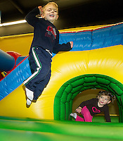 "Jasper and Rowan Sottak happily jump during the first annual ""Jump-a-thon"" at Jump 'N Joy on Sunday to benefit the 2012 WLNH Children's Auction.  (Karen Bobotas/for the Laconia Daily Sun)"