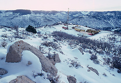 Stock photo of an on-shore workover drilling site in a snowy mountainous area of Colorado