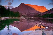 Colorful Sunset Lights Up Haystack Mountain Reflected in Clear Lake in the Wind River Range of Wyoming