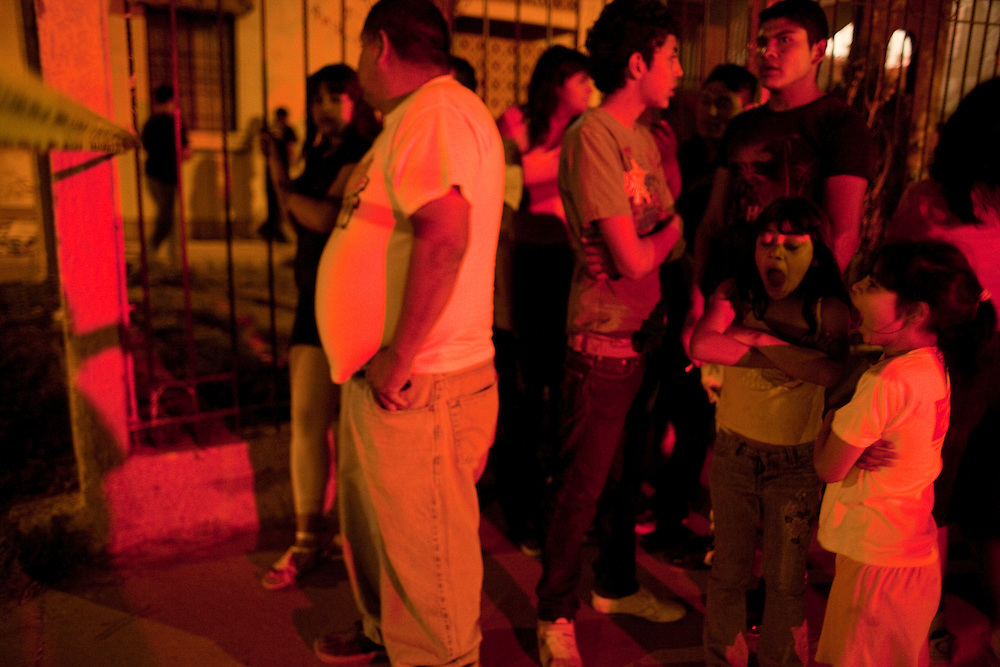 Neighbors come out to the scene of a murder in the Las Torres colonia in Ciudad Juarez, Chihuahua on May 15, 2010.