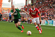 Derrick Williams (right) of Bristol City takes the ball on from Neil Bishop (left) of Scunthorpe United during the Sky Bet League 1 match at Ashton Gate, Bristol<br /> Picture by Tom Smith/Focus Images Ltd 07545141164<br /> 06/09/2014