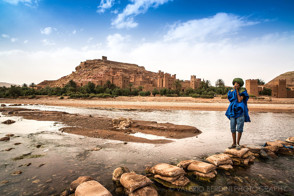 A Berber guide crosses the river on an improvised bridge made with concrete sacks in Aït Benhaddou. This city, sited in Morocco, on the road from Marrakech to Sahara, has become famous for having staged several Hollywood blockbuster movies including the Gladiator and the Passion of Christ, and is protected by UNESCO as a world heritage site.
