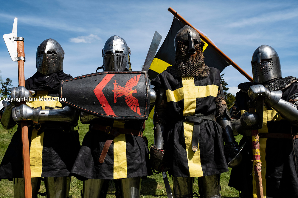 English knights prepare for combat during the  International Medieval Combat Federation (IMCF) World Championships  at Scone Palace on May 12, 2018 at Scone Palace in Perth, Scotland.