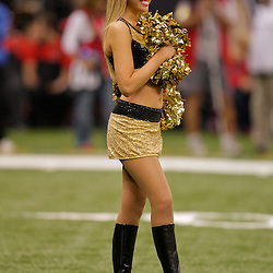 2009 October 18: A New Orleans Saints Saintsations cheerleaders performs on the field during a 48-27 win by the New Orleans Saints over the New York Giants at the Louisiana Superdome in New Orleans, Louisiana.