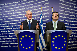 "George Papandreou, Greece's prime minister, left, speaks as Jose Manuel Barroso, president of the European Commission, listens, during a press briefing following their meeting at the European Union Commission headquarters in Brussels, Belgium, on Wednesday, March 17, 2010. German Chancellor Angela Merkel said the European Union must avoid any ""overly hasty"" aid pledge to Greece. (Photo © Jock Fistick)"