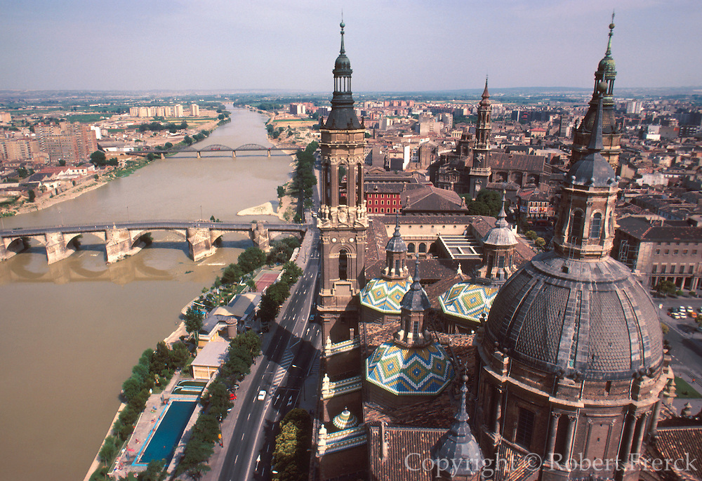 SPAIN, ARAGON ZARAGOZA; the Rio Ebro passing below the spires and domes of the famous 17th century Cathedral of Nuestra Senora del Pilar