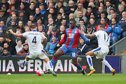 Yannick Bolasie (10) of Crystal Palace takes on Leicester City midfielder Danny Drinkwater (4) and Leicester City defender Danny Simpson (17) during the Barclays Premier League match between Crystal Palace and Leicester City at Selhurst Park, London, England on 19 March 2016. Photo by Phil Duncan.