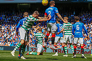 James Tavernier (C) of Rangers FC gets pushed in the back  during the Ladbrokes Scottish Premiership match between Rangers and Celtic at Ibrox, Glasgow, Scotland on 12 May 2019.