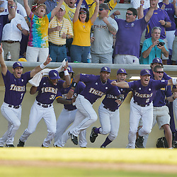 06 June 2009:  LSU players charge for the pitchers mound in celebration following a 5-3 victory by the LSU Tigers over the Rice Owls in game two of the NCAA baseball College World Series, Super Regional played at Alex Box Stadium in Baton Rouge, Louisiana. The Tigers with the win advance to next week's College Baseball World Series in Omaha, Nebraska.