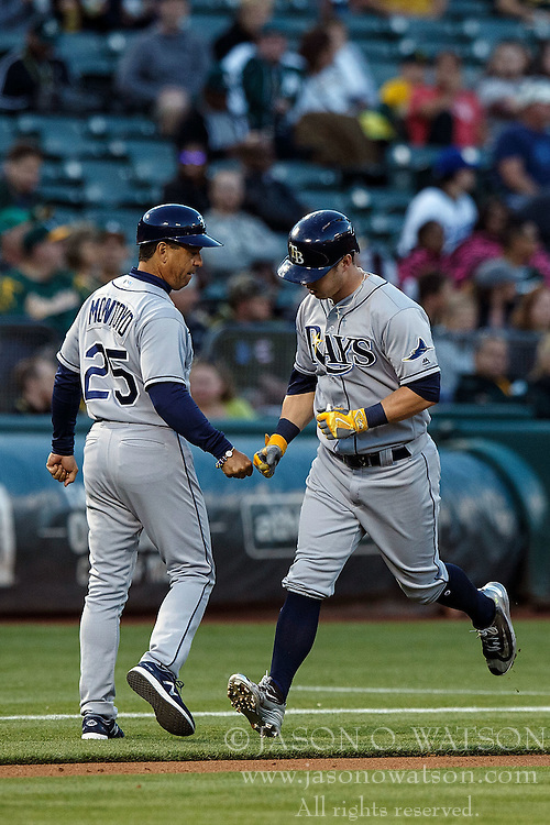 OAKLAND, CA - JULY 21:  Corey Dickerson #10 of the Tampa Bay Rays is congratulated by third base coach Charlie Montoyo #25 after hitting a home run against the Oakland Athletics during the fourth inning at the Oakland Coliseum on July 21, 2016 in Oakland, California. (Photo by Jason O. Watson/Getty Images) *** Local Caption *** Corey Dickerson; Charlie Montoyo